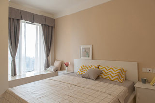 温馨浅黄色卧室装修效果图