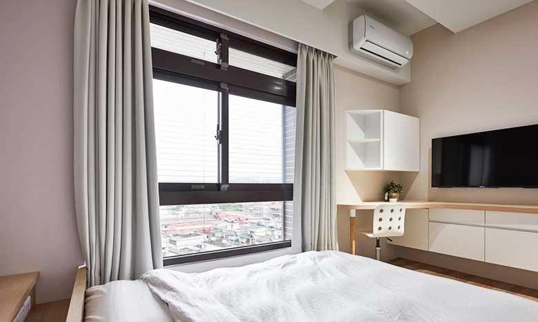 105㎡新中式两居室卧室摆放图
