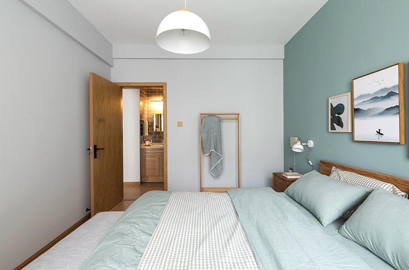 52平一室一厅装修卧室床品图片
