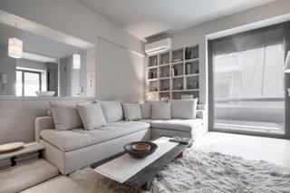 白灰色现代公寓装修沙发布置图