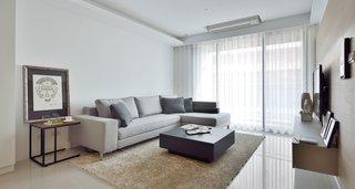 现代简约二居室沙发背景墙装修效果图