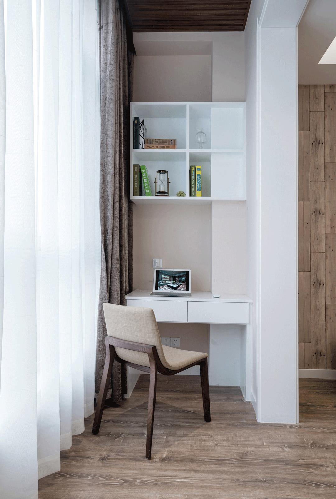 简约现代风格三居阳台书桌装修效果图